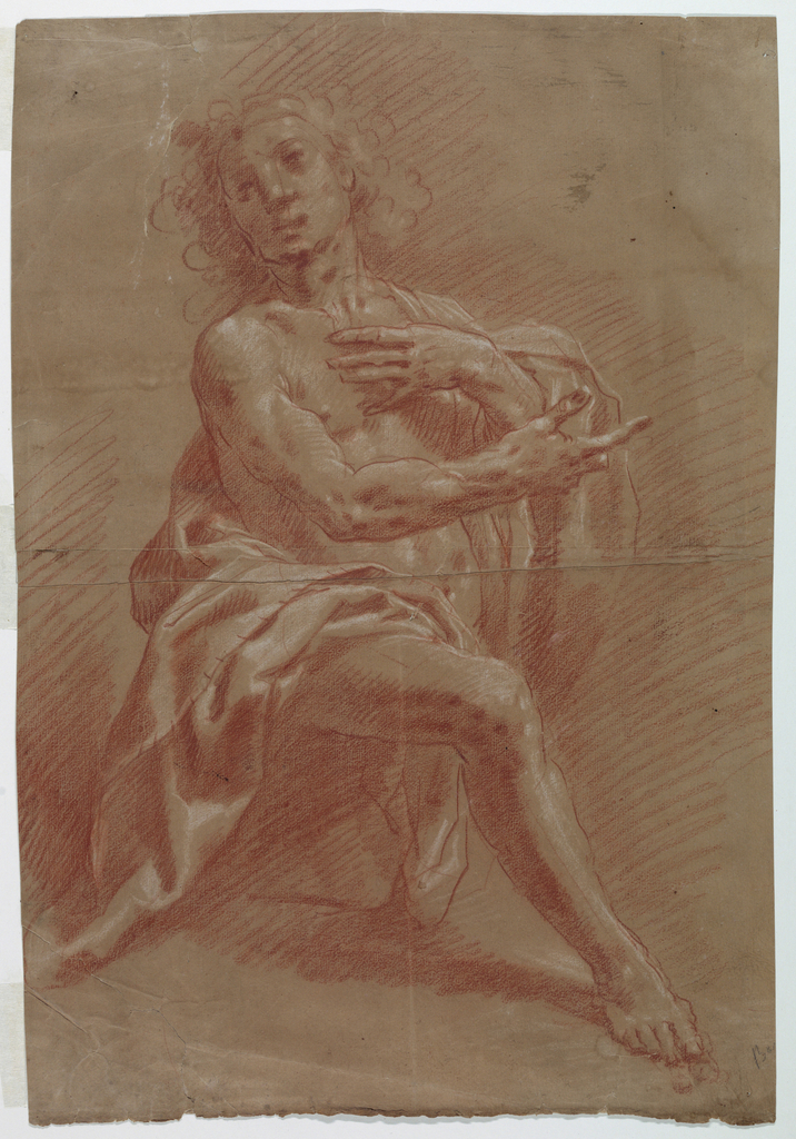Kneeling man with right hand pointing and left lying upon his breast.