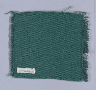 Solid green sample with short warp fringe.