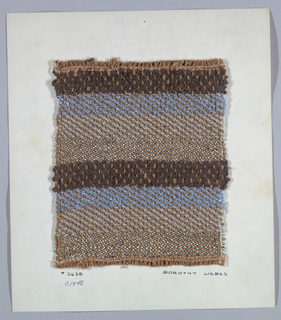 Warp has narrow four-ply brown yarn alternating with textured two-ply brown yarn. Weft has bands of gray boucle, blue boucle, brown chenille and flat silver metallic paired with wrapped metallic yarns.