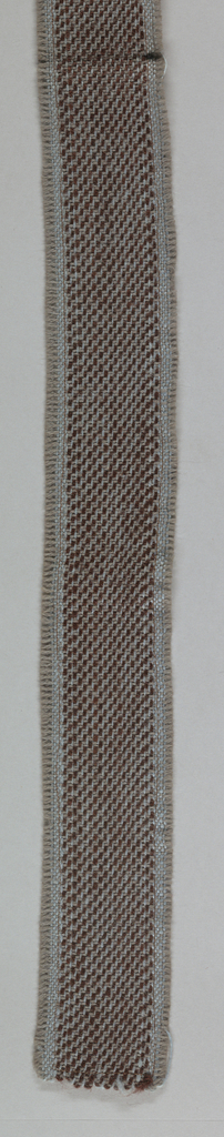 Gray warp; chocolate brown and pale blue wefts used alternately.