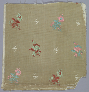 Small floral sprays in red. Rose and green on a cream colored ground.