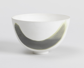 Deep round bowl on small circular base by Wilhelm Kage.  White eggshell-thin unglazed porcelain with one U-shaped sweep of green and gray.