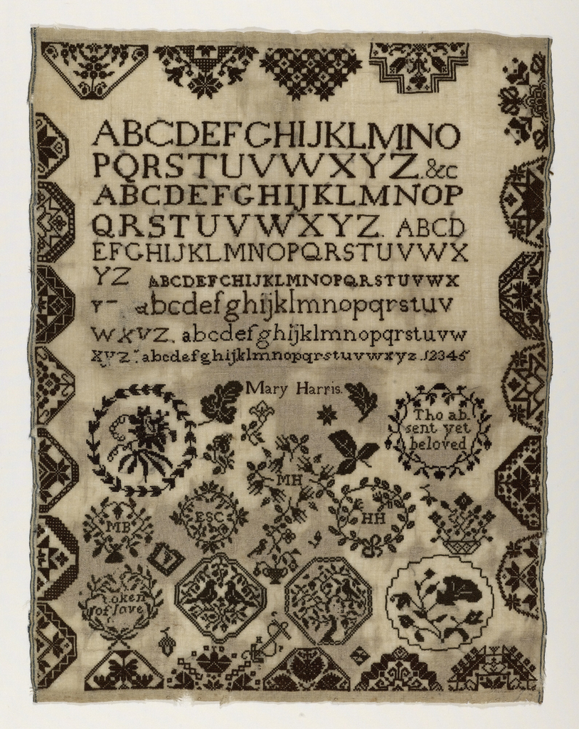 """Sampler worked by Mary Harris in black thread on a natural ground. A border of twenty-two half-lozenges. The upper half of the field has seven alphabets. The lower half of the field is filled with pattern lozenges and wreaths, with baskets of flowers, birds, initials and sentiments: """"Tho absent yet beloved,"""" """"Token of love."""""""