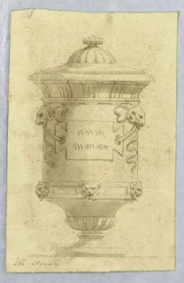 Vertical rectangle showing urn decorated with masks