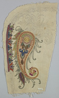Sample of white cotton with an unfinished embroidery design in multi-colored silks and wool of a large paisley motif with a floral border. Paisley motif has a central rosette in beadwork.