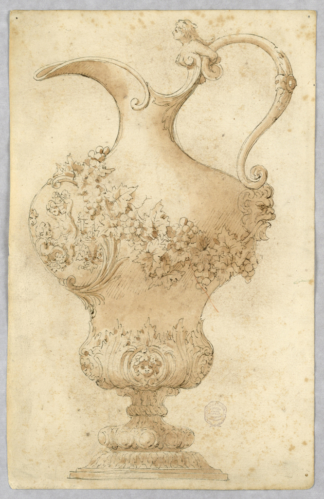 A footed double-bellied ewer, spout facing left. Scroll with upper part of a woman forms the handle. Mask at bottom of handle. Garland of grape vines around body. At front, a cartouche with figures of putti. Acanthus leaves and masks at bottom.
