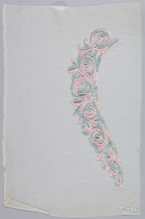 White chiffon ornamented with scrolling design worked in pink and green plastic spangles.