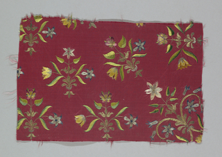 Red taffeta embroidered in floral design in polychrome silks, and gold and silver wound on silk cord. Satin and stem stitches.