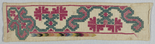 Sampler showing a geometric floral vine in red and green silk on linen, with a partial border of  multicoloured chevron.