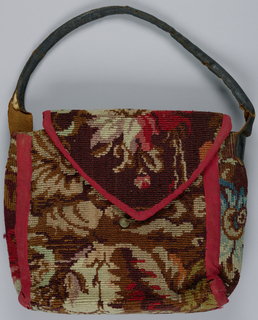 Wide envelope bag with turnover flap; loop handles of leather. Floral pattern in taupe, pinks and reds on a brown ground.