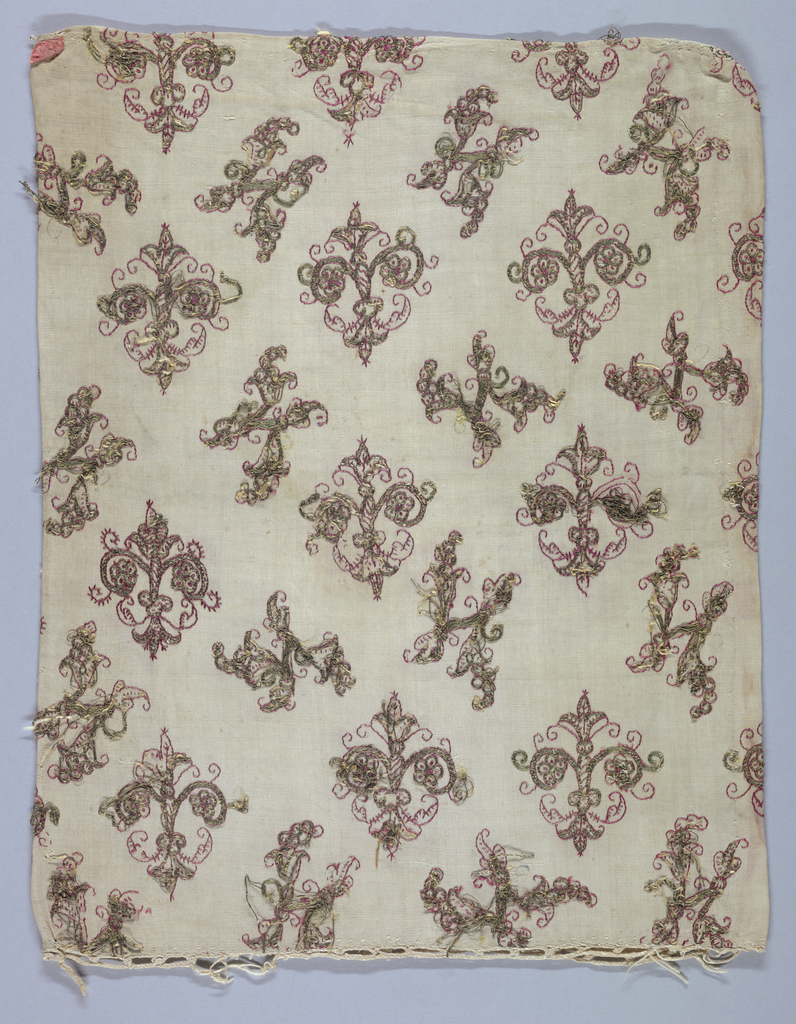 Linen, embroidered in red silk and metal thread. Pattern of detached motifs in alternate rows; one row a stylized plant evolved from fleur-de-lys; second irregularly-shaped floral spray. Red silk running stitch form outline of pattern; parts worked in couched metal thread (gilded parchment wound on linen core. Loops at one end for fastening by cord. Backed with linen pieces.