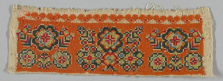 Rectangular panel with three symmetrical floral repeats embroidered in green, blue, red, white and black silk and wool on a predominantly orange embroidered ground in a variety of surface stitches.