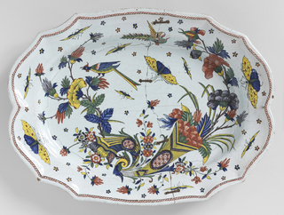 Irregular scalloped border, oval cavetto. Decoration in Chinese style. Double cornucopia with flowers, large insects and a long-tailed bird