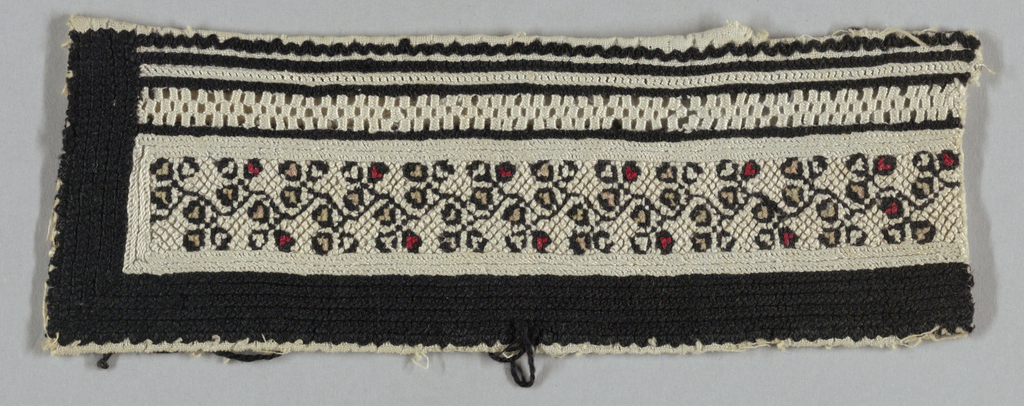 Black and white embroidery on white cotton. Black and white stripes with a stylized floral design in beige, red and black with a narrow grid of cutwork embroidery.