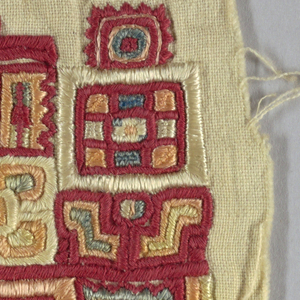 Square of cotton solidly embroidered in an allover geometric pattern.