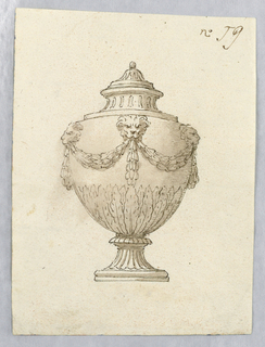 Vertical rectangle showing vase decorated with lion masks and swags