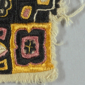 Square of cotton solidly embroidered in an allover geometric and stylized floral pattern.