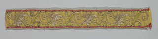 Narrow yellow band with a red border on top and bottom embroidered with scrolling leaf forms using metal threads.