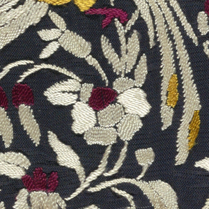 Open tabby black silk square embroidered, mostly in satin stitch, in white, red, and yellow silks. Bird and flower design.