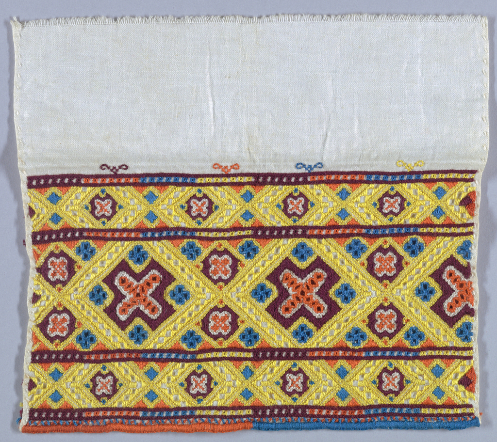 Fragment of a cuff band embroidered in an allover geometric pattern in yellow, orange, blue and purple.