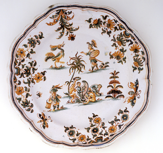 "Octagonal, with a scalloped edge.  Decorated with grotesque figures including a monkey band and a helmeted man carrying a shield inscribed ""San-Peur"" (Without Fear).  Border of insects and flowers.  Grayish green and ochre on white ground."