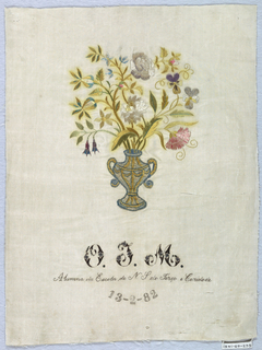 "A vase of flowers and the inscription ""O.T.M. Alumna da Escola de N S do Terço e Caridade 13-2-82"" (Alumna of the School of Our Lady of Charity)"