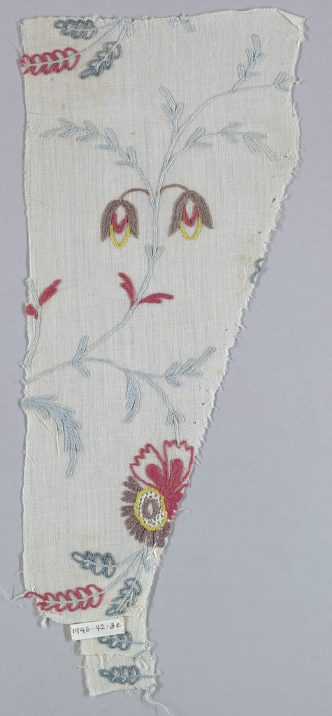 Embroidery in design of curving stems with flowers, buds and leaves in blue, red, brown, and silver thread.