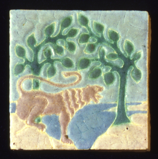 Light buff earthenware body with press-molded design of lion on haunches backed by stylized trees and landscape.  Tan, cream, light blue, and green mat glazes defined by raised partitions.
