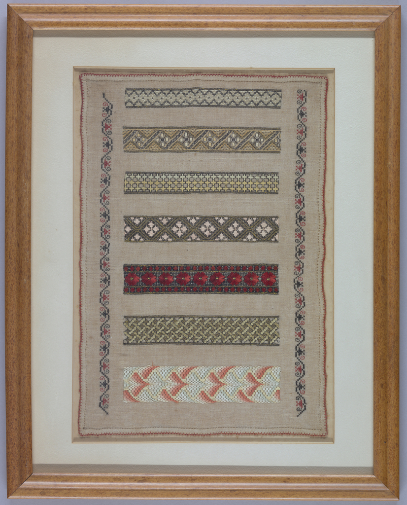 Sampler of pattern bands worked in black, light green, yellow, orange, red, pink and white silk and gilt-wrapped silk core on natural linen.  Densely worked pattern bands in running, satin, chain, daisy and cross stitch with bargello work; hem stitched and picoted edge.