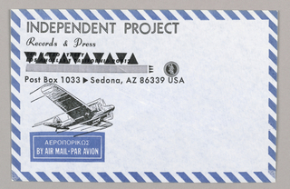 Horizontal format airmail envelope for Independent Project Records & Press, bordered in blue and white diagonal stripes. At upper left, printed company name and updated Arizona address, an older California address visible above, marked out by a pattern of solid triangles alternating direction. At lower left, image of a biplane in flight, blue horizontal rectangle below with printed text in Greek and Roman letters identifying the envelope as airmail.