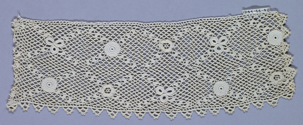 Two pair of crocheted lace cuffs in white linen.  a,b with roses and shamrocks on a picotee ground c,d in an overall lozenge design