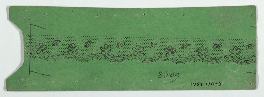 Green cardboard pattern with pricked design for bobbin lace and motif drawnin ink. Scalloped edge on one side.