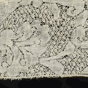 Border of Binche style lace with a scroll pattern.