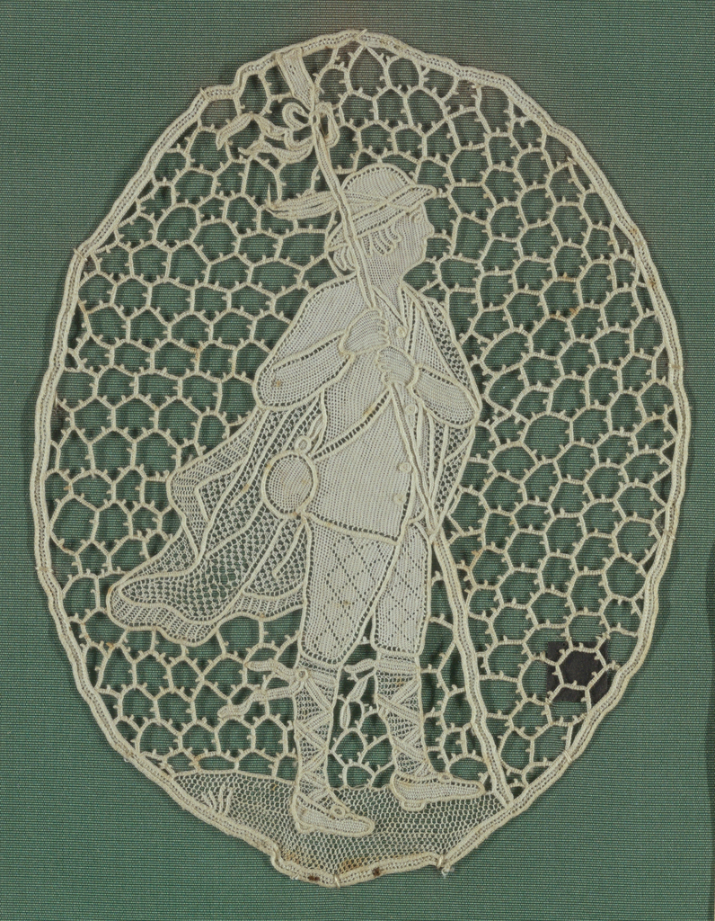 Oval shape  with a human figure motif. (piece on lace study chart)