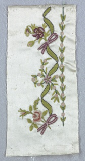 White satin embroidered using colored silks in designs of flowers on curving stems intertwined with ribbons or floral sprays with ribbons.