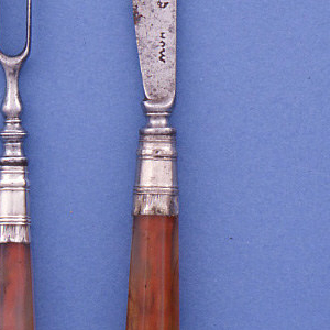 Two tined fork, curved shoulders, baluster neck. Silver ferrule engraved, agate handle, metal pin on top of handle.