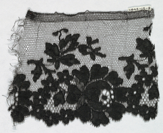 Black Spanish-style blonde lace with pattern of large and small flowers and leaves and hexagonal reseau.