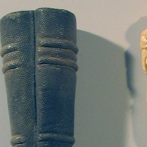 Sabre-shaped blade with straight upper edge; globular bolster. Plain silver ferrule, round in section. Carved ivory handle, representing Zeus/Jupiter, holding a thunderbolt in one hand and a scepter in the other. In front of him stands an eagle, his wings spread around the legs of Zeus/Jupiter.