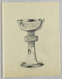 Presentation design for silver chalice with wide shallow cup with engraved motif of Aztec-style angel face with wings on either side and radiating sun; decorative diagonal stripes on stem; small graphite right angles in corners indicate perimeters of  design; cushion piece on upper part of stem decorated with scallop and bead motifs.