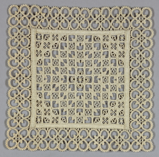 Central square of withdrawn element with a geometric pattern of squares. Corners of the square more heavily worked to create a diamond shape within the square. Border consists of a series of circles that form quatrefoils.