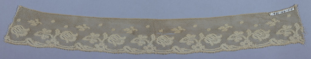 White imitation Valenciennes. Design of floral sprays on diamond reseau; one border scalloped. Type made on Levers machine.