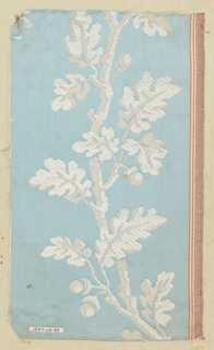 Light blue ground with white meandering oak branch laden with leaves and acorns. Adhered to sample card 1937-63-19.