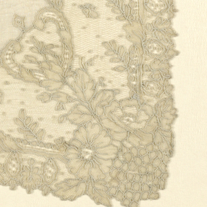 Handkerchief with a linen center and trimmed with Point de Gaze needle lace. Pattern shows medallions and floral elements.