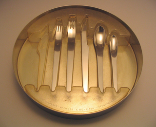 Cutlery tray with plastic insert.