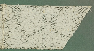 Band with cloud-like forms with scalloped areas. Sewn to 1897-8-10