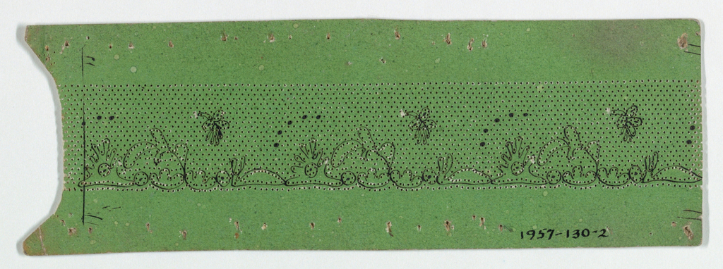 Green cardboard pattern with pricked design for bobbin lace and motif drawnin ink.