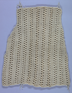 Fragment of crochet in off-white wool, in a striped design.