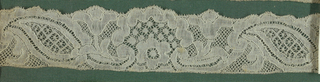 "Lace fragment with a five-hole ground referred to as ""fond à cinq trous."" Fragment is mounted on a fabric-covered board and framed behind glass. Frame is natural wood."