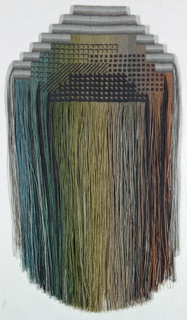 Hanging, stepped at the upper edge, patterned with small geometric forms in black, and with long multicolor fringe shaped into a curve at the bottom. Muted colors ranging from blues and greens to yellow and red, with black.