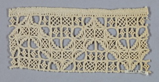 A geometric design based on the square. Zigzag formed by spacing of closely worked squares.